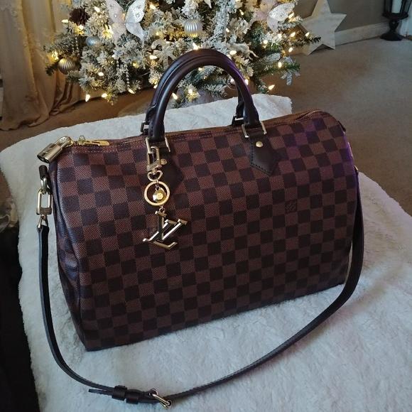 46b65cc9ec7fa Louis Vuitton Speedy B 35 w/LV facettes charm